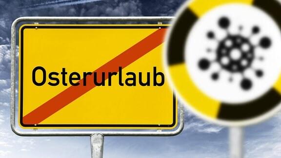 Ortsschild mit der durchgestrichenen Aufschrift Osterurlaub und Schild mit Coronavirus-Symbol
