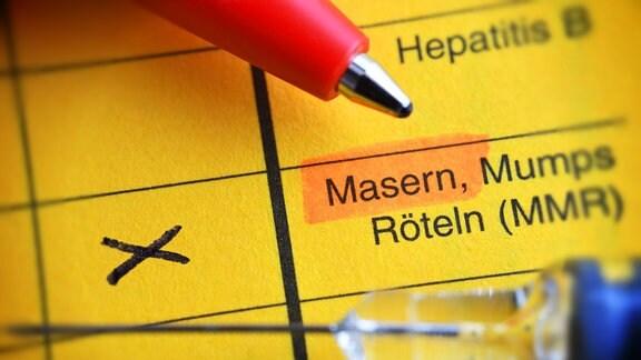 Impfausweis mit angekreuzter Masern-Impfung