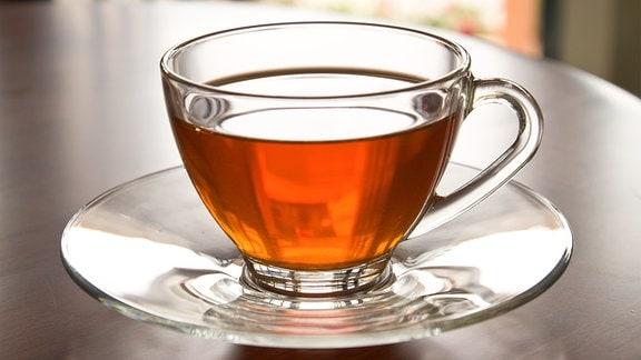 Glastasse mit Tee