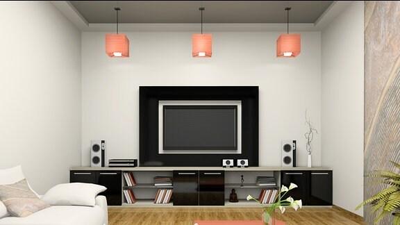 Eine Heimkino-Anlage im Wohnzimmer.
